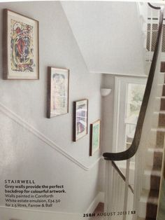 Very light grey walls with carpets that are a shade or two darker. Like the dark wood hand rail with white banisters.