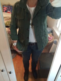 Old Navy Military Jacket ($29.95), Faded Glory white tee ($7.54), Lauren Conrad skinny jeans ($18.00), Unionbay black motorcycle boots ($29.99), Charming Charlie's antique gold cross ($14.95) and Michael Kors Layton stainless Watch.