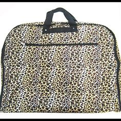 New Brown Leopard Garment Bag Travel Luggage Brand New w/ Tags! This is a stylish garment bag that will stand out in a sea of bags at the airport. Would be great for dance, pageant, cheer or any travel. Check out our matching duffles and laptop bags and bundle them. Ask if you need a larger quantity or a matching bag.  Size : 24 x 20 in.   * Opens up to size 24 x 40 inches  Material : Canvas   * Zipper Closure   * Zipper Pocket on Front  * Zipper Compartment Inside w/ Clothes Hanger  Color…