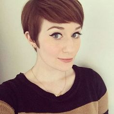 chic short pixie cut with side swept bangs