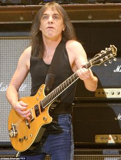 Retired: AC/DC guitarist and co-founder Malcolm Young has reportedly retired from the Australian band due to an ongoing battle with dementia Ac Dc Guitarist, Malcolm Young, Ac Dc Rock, Bon Scott, Angus Young, Music Pictures, Famous Singers, Blues Rock, Pretty Men