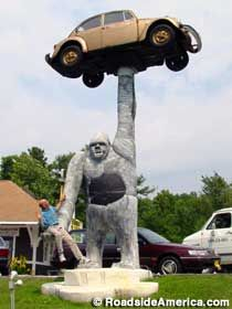 Gorilla Statue holding a VW Beetle - Pioneer Auto Sales - Leicester