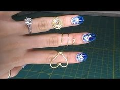 Three pretty easy rings to make out of a 20 gauge wire.    Supplies were all bought from Michael's Craft Store here is a coupon for 40% if you guys wanted to save a bit of moolah: http://dealspl.us/michaels-coupons    Wire cutter, Round nose pliers, Pliers, 20 gauge gold wire.    Heart ring is not an original idea. I just changed a few steps to ...