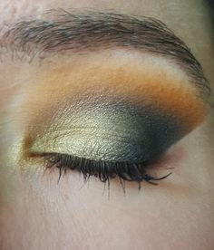 Urban Decay Basquiat Gold Griot palette and a hot orange single from NYX