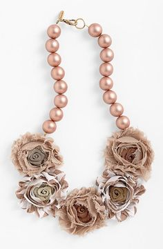 Floral fabric statement necklace with a vintage feel