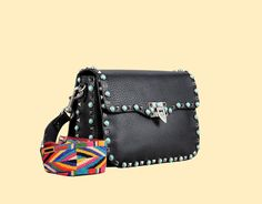 It's here: Valentino Rockstud Rolling Crossbody Bag with ethnic print strap!  Shop here: http://bit.ly/1Oa5mEQ  ‪#‎fatimamendes‬ ‪#‎miss‬ ‪#‎style‬ ‪#‎maisonvalentino‬ ‪#‎ss16‬