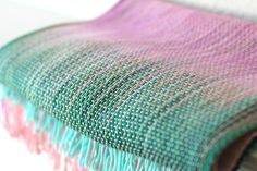 """<p>Hand woven long scarf with gradually changing colors from pink to green and mint.</p> <p>Measures: <br>L: 78"""" with 6"""" fringe on both ends W: 11""""</p> <p>Care instructions... #kgthreads"""
