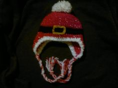 Santa hat. I just used this pattern http://www.repeatcrafterme.com/2012/09/crochet-owl-hat-pattern-in-newborn.html but made it into a Santa hat