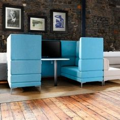 High back seating units offer comfort and privacy ideal for meeting and public spaces