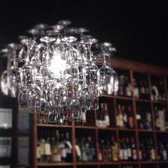 Wine glass chandelier at Lush Wine and Spirits