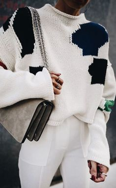 Casual chic black and white outfit with taupe suede handbag.