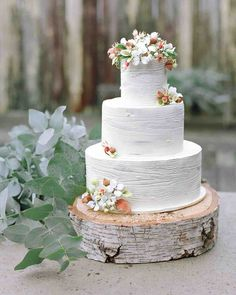 11 Reasons We're Dreaming of a White Winter Wedding Cake | Martha Stewart Weddings - Perfect Endings bakery gave the frosting of this genoise cake a faux-bois finish for a whitewashed look.