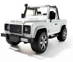 Bruder Toys Land Rover Defender Pick Up by Bruder Toys. $34.44. Drivers cabin made with transparent high quality polycarbonate and the doors can be opened. Doors, tailgates and hood can be opened, while hood support allows for realistic engine block  viewing. Spare wheel on tailgate, removable rear bench seat, chasis has removable drawbar coupling and includes a front (steerable) and rear axle suspension. Additional steering rod allows steering through sliding roof. From the...