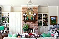 Eclectic decor; you can make this look in your home too! Loving the leather, pattern mixing and exposed brick