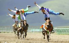 Tibetan horse riders perform at a traditional equestrian event in Hongyuan county of Aba Tibetan and Qiang Autonomous Prefecture, Sichuan Province