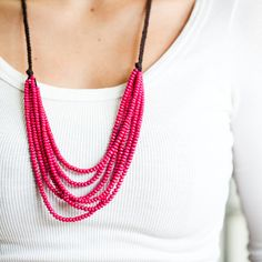 Hey, I found this really awesome Etsy listing at http://www.etsy.com/listing/101965434/pink-wood-bead-handmade-necklace-on