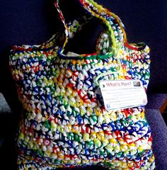 I love this idea- recycled plastic bags knit with colorful yarn for grocery shopping bag.