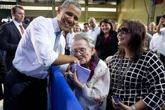 : Carolina Garcia Delfin, 94, a Filipina nurse who fought in the resistance against Japanese forces during World War II, kisses President Obama after he mentioned her in his remarks to American and Philippine troops at Fort Bonifacio in Manila, Philippines, April 29, 2014