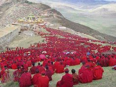 Like beautiful Poppies growing across the landscape. This is a photo of a protest in Tibet taken recently. A beautiful and moving image of the right way to get your message across. We Are The World, People Around The World, Around The Worlds, Buddhist Monk, Tibetan Buddhism, Buddha, Monte Everest, Rose Croix, Art Asiatique