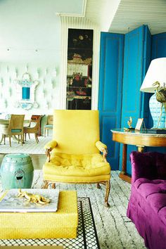 Interior Designer Miles Redd combines color like no one else.  A bold yellow chair plays well with a bold blue screen and purple couch.