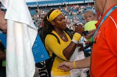 Serena Williams signing autographs at a previous Western and Southern Open