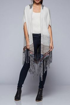 Fringe knit poncho with contrast hood and beautifully marled striped border.   Hooded Fringe Poncho by Love Stitch. Clothing - Sweaters - Ponchos & Capes Texas
