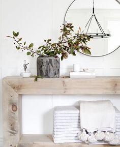 Hallway console table.   #LightingDesign #lighting #consoletable #neutralcolors #neutralhome #naturalwood #onlineshopping #lightsonline #hallway #chandelier #mirror