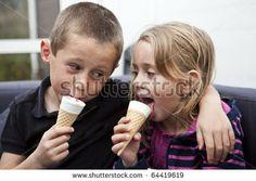 Happy Siblings eating ice-cream - stock photo