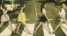 Stylish gals crossing Abbey Road.