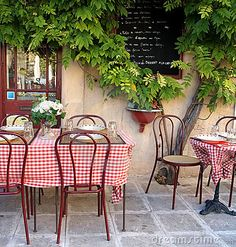 French cafe in Provence by Rosamund Parkinson, via Dreamstime