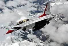Maj. Curtis Doughtery a slot pilot for the Thunderbirds banks right over the Rocky Mountains after being refueled in flight by a KC-135 Stratotanker from McConnell Air Force Base Kan. May 21 2015 [2.880px  1.973px]