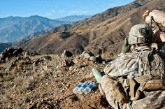 Soldiers assigned to Bayonet Company, 2nd Battalion, 327th Infantry Regiment, Task Force No Slack, searches for insurgents on a rocky mountainside overlooking the Ganjgal Valley in eastern Afghanistan's Kunar Province, Dec. 11, 2010. KUNAR PROVINCE, Afghanistan. The Task Force No Slack Soldiers were supporting Operation Eagle Claw II.