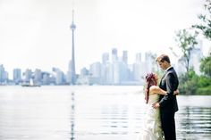 There's nothing cooler than the Toronto skyline behind your unique couple photo - Wedding Couple Photos, Wedding Couples, Toronto Skyline, Newlyweds, Real Weddings, Backdrops, Wedding Photography, Bride, Wedding Dresses