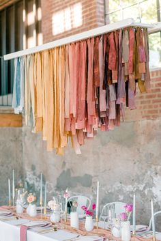 Learn about the creative process behind the muted rainbow ribbon chandelier that adorns this chic industrial micro wedding celebration. Ribbon Chandelier, Event Planning, Wedding Planning, Decoration Vitrine, Rainbow Ribbon, Hanging Fabric, Partys, Diy Wedding, Wedding Ribbons