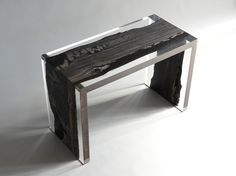 Peatland Bench is made with unusual black trunks of Oak trees lain in a small Alpine peat. Their age is the fifth century before Christ.