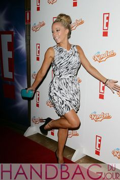 Kendra-Wilkinson-Baskett-posed-on-the-red-carpet-at-the-Ivy-in-Sydney,-Australia,-promoting-her-show,-toting-a-turquoise-Alexander-McQueen-Box-Clutch