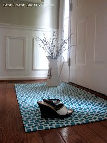 DIY Fabric Floorcloth - spray glued to cheap rubber mat and coated with poly to repel water
