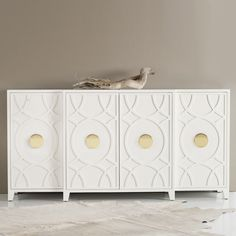 The Somerset Bay Transitional credenza offers concealed storage to modern interiors. This solid wood furnishing stuns with a carved trellis-inspired pattern and bold brass handles. Solid mahogany; Multiple finishes available; Brass hardware; 4 doors; 3 interior shelves; Wipe with damp cloth, dry with soft cloth to clean; 78in W x 20in D x 39in H