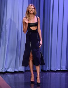 Karlie Kloss Cutout Dress - Karlie Kloss dared to bare in a black David Koma zipper-detailed midi dress complete with a bralette while making an appearance on 'The Tonight Show Starring Jimmy Fallon' in NYC.