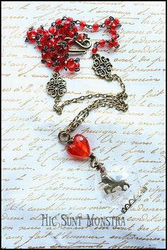A long and mystic necklace devoted to one of my favourite fantasy animals: the unicorn. Plenty of warm colour - with the red of the glass heart bead and the rosary crystals matching with the bronze tone of the chain, connectors and unicorn charm itself, which will inspire you and lead you directly to a fantastic lands of good feelings. 15% of the sale of this creation will go to animals quite less fortunate than the Unicorn.