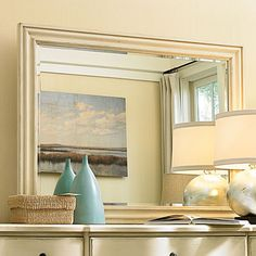 Rectangular dresser mirror with a beveled frame.  Product: Dresser mirrorConstruction Material: Wood and mirrore...