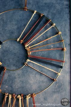 """DIY Leather Dream Catcher"" :: great idea for a WREATH, too!"