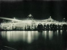 Night view of the Palace of Electricity illuminated from across the Grand Basin at the 1904 World's Fair.