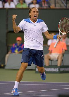 Alexandr Dolgopolov, of Ukraine, celebrates as he defeats Rafael Nadal, of Spain, their match at the BNP Paribas Open tennis tournament, Monday, March 10, 2014, in Indian Wells, Calif. Dolgopolov won 6-3, 3-6, 7-6 (5). (AP)