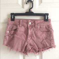 American eagle high waisted shorts Worn a few times. High waisted, pretty short. Would fit a shorter girl better! Washed out red, style is faded. American Eagle Outfitters Shorts Jean Shorts