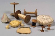 Ten Assorted Shaker Sewing Articles, America, 19th century, including six turned wooden spools, three large and three small; two floral pattern satin covered pincushions, one yellow, one ecru; a poplarware needlecase, and silk covered case containing a a silk needlecase, (minor wear), lg. 7/8 -4 in.