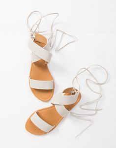 Get caught up in these light gray Lace-Up Strapped Sandals. Pair these sandals with a strappy tank and frayed denim shorts for a casual day out.
