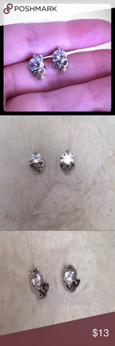 Simulated Diamond Skull Earrings Silver plated Simulated Diamond stud earrings. Amazed with the sparkle. These give To any outfit. For those edgy chicks! Jewelry Earrings