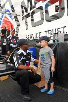 Antron Brown & Team racing at the Summer National's in the Matco Tools Nitro Dragster