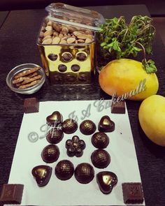 assorted chocolates with flavours of Fresh Mango Punch  Coffee with Cookies Roasted Almonds Sesame Praline